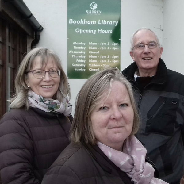 Bookham South Councillor Elizabeth Daly (centre, seen with campaigners Nancy Goodacre and Roger Adams) is determined to prevent the closure of Bookham Library and reverse previous cuts. She says: